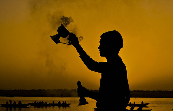 Greeting the Sun God - Benares, India