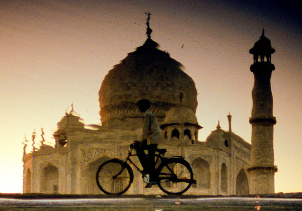 Boy and Taj Mahal in River