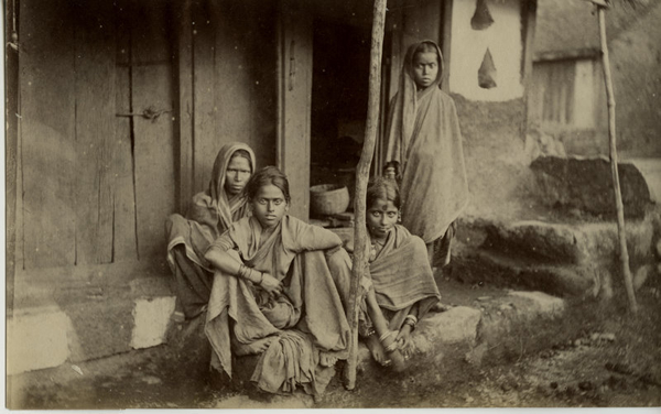 Indian Woman and Girls Outside of a House