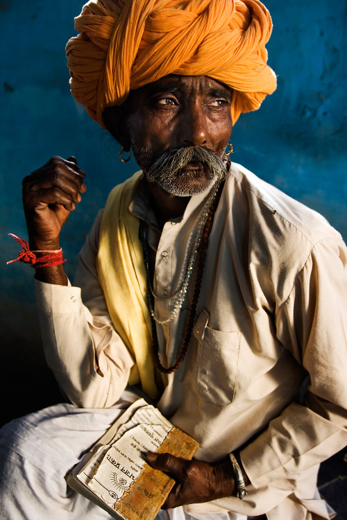 Man with a Religious Songs Book - Outskirts of Bundi, India