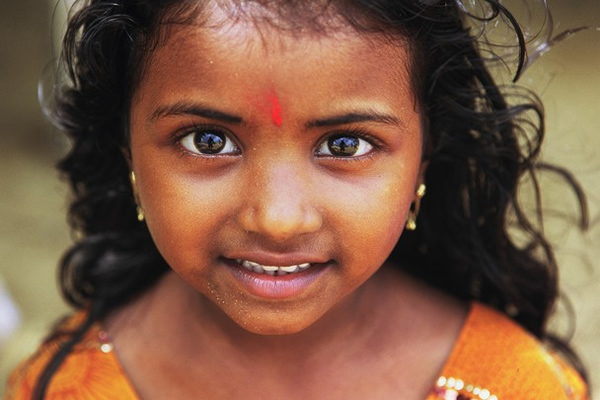 Little girl in Poovar India