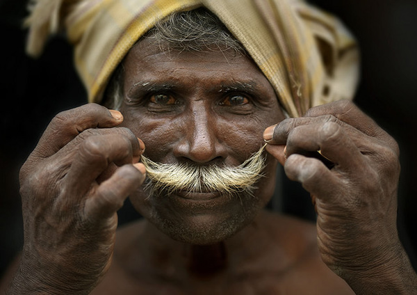 Man curling his moustache, India