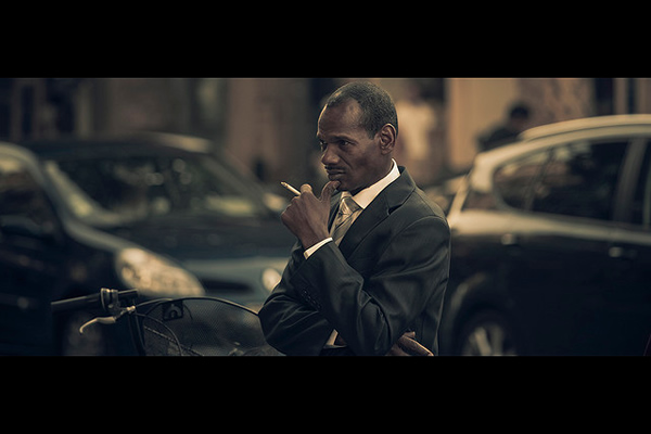 Black Suit & Cigarette - 35 Awesome Examples of Cinematic Photography