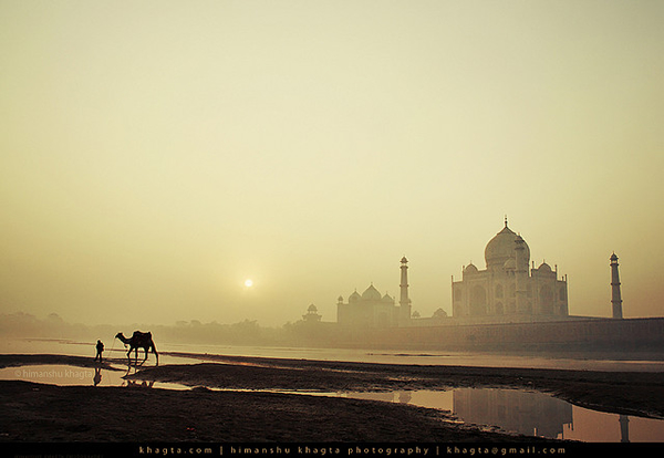 Taj Mahal with a Camel and his owner by Himanshu Khagta
