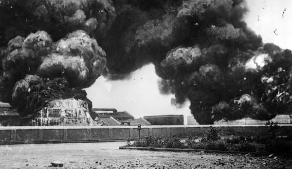 Oil tanks on fire in Madras Harbour during the First World War