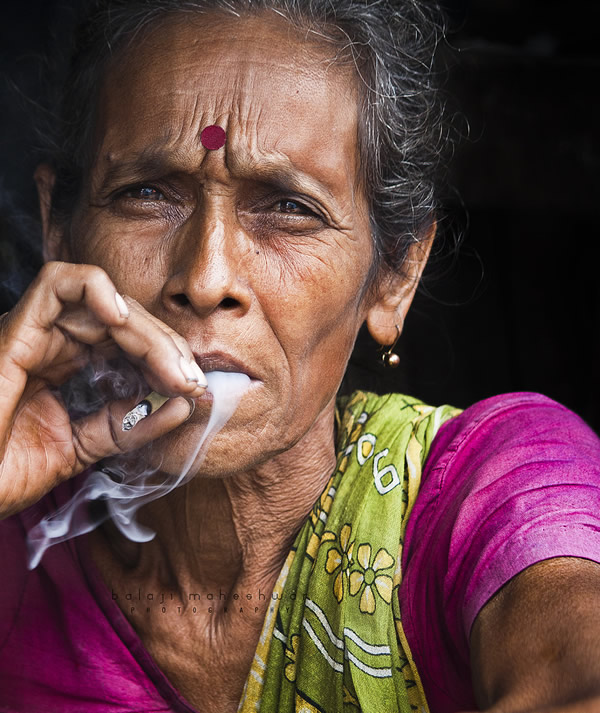 woman smoking beedi.took this in a flower market near howrah
