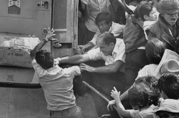 An American evacuee punches a South Vietnamese man for a place on the last chopper out of the US embassy during the evacuation of Saigon in 1975.