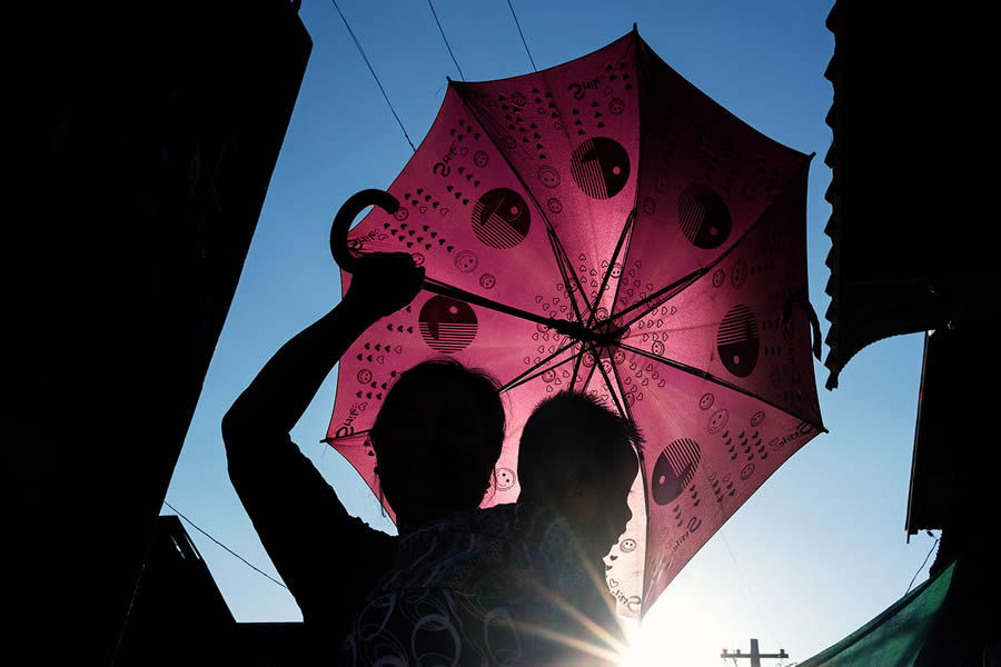 Umbrella - Mawlamyine, Myanmar - Street Photography and the art of composition photos