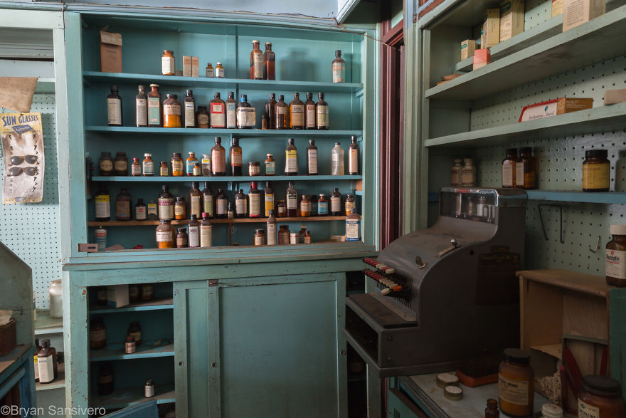 Vintage cash register and medicines sit as if were being used yesterday