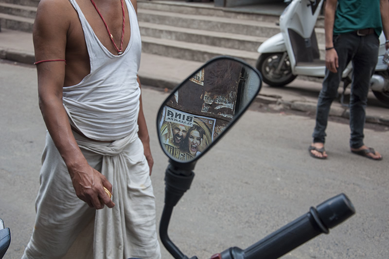 Conversing With The Posters: Street Photography Series By Niladri Adhikary