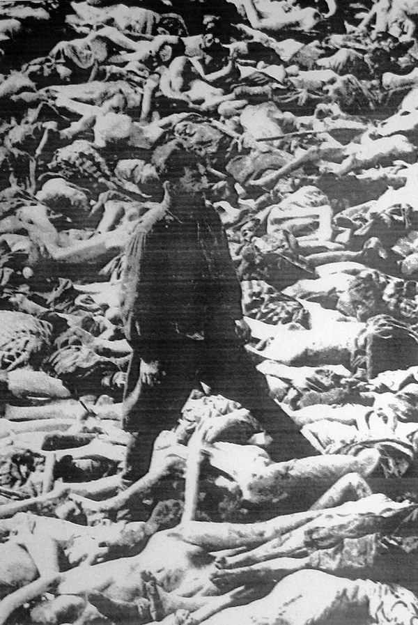 Dr Fritz Klein is standing in a mass grave