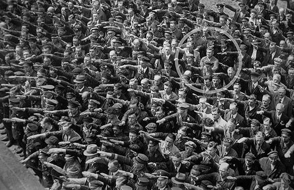 He stood alone, refusing to join the Nazi salute in 1936.