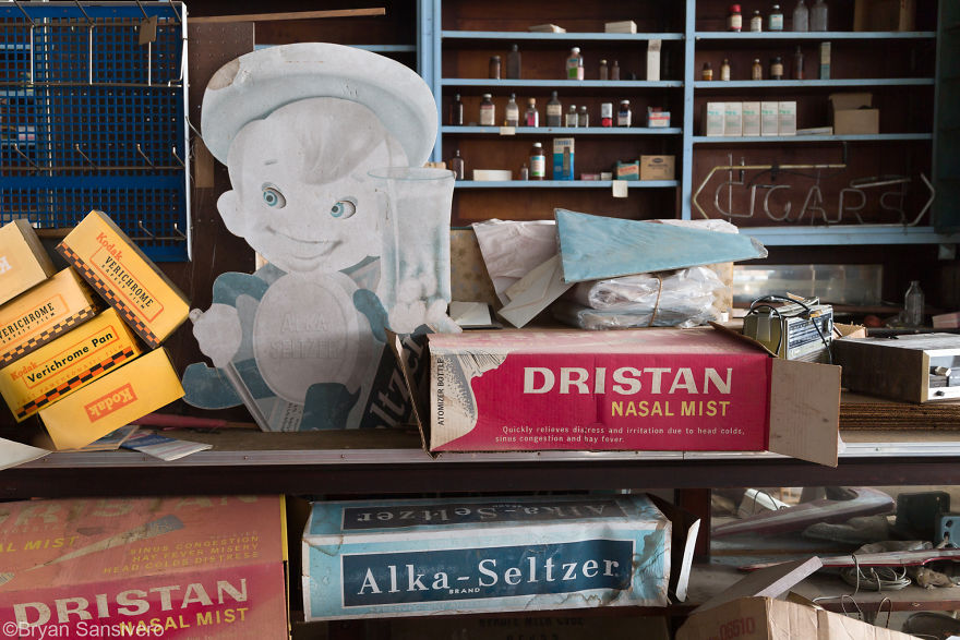 Vintage advertising and shelves with bottles