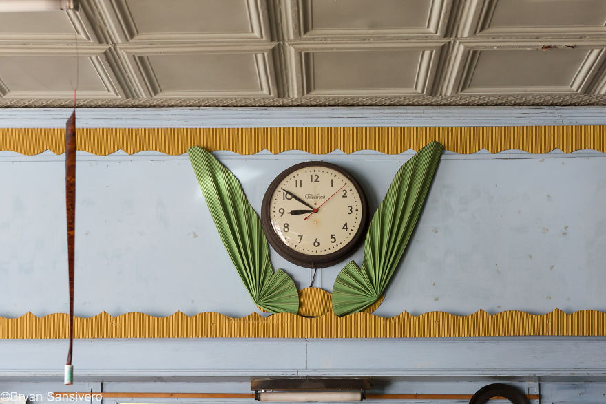 An old clock still hangs on the wall