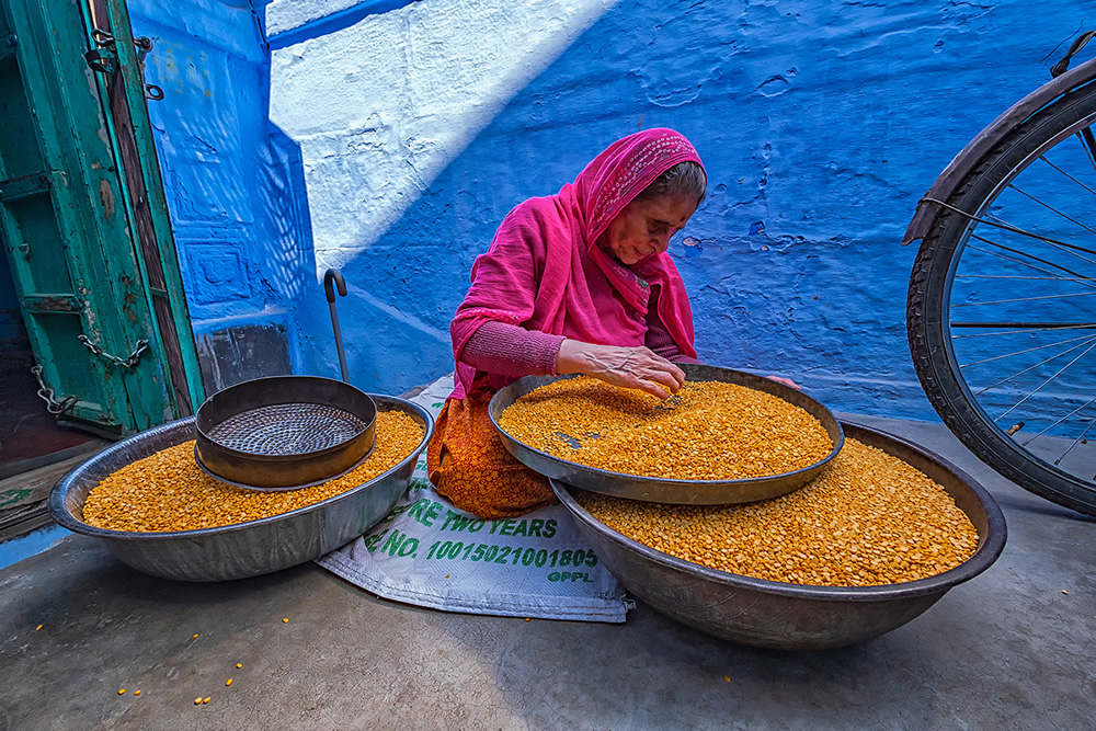An old lady with pulses inside the blue city of Jodhpur, Rajasthan