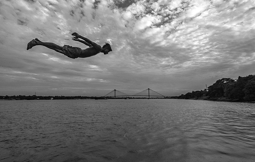 Flying Boy in Howrah with 2nd Hoogly bridge in backdrop over River Ganges